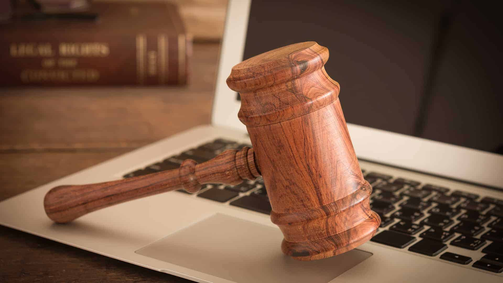 gavel resting on a computer