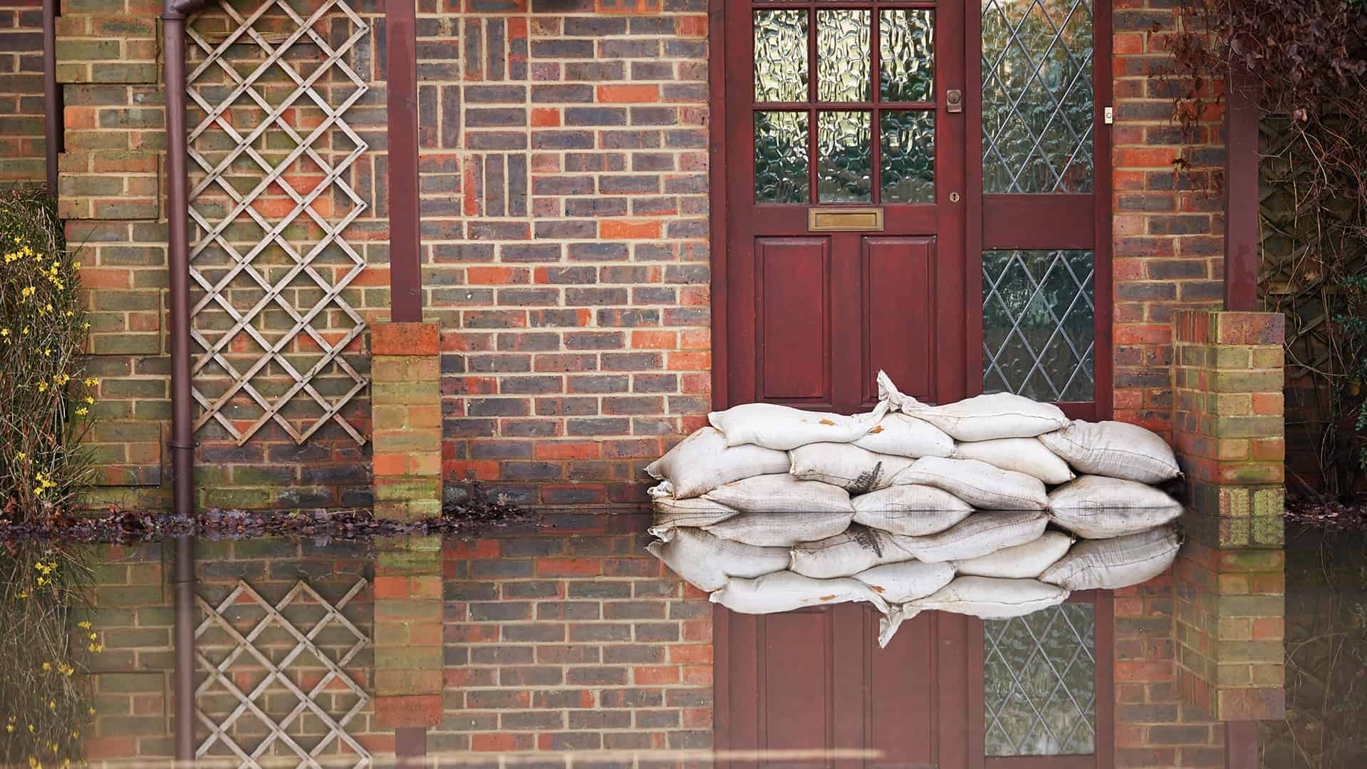 Flooded house with sandbags our front