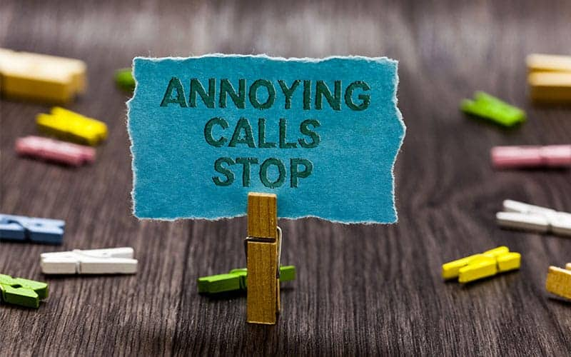 A clip holding a paper stating annoying calls stop