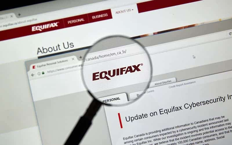 A magnifying glass focusing on equifax